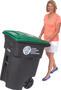 Photo of Mayor Stothert with a green lid recycling cart